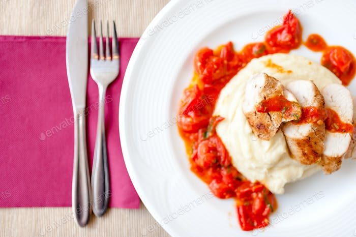 pork chops with mashed potatoes and spicy tomatoes sauce