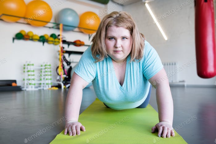 Motivated Obese Woman in Workout