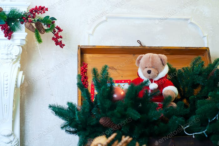 Christmas teddy bear in  tree branches
