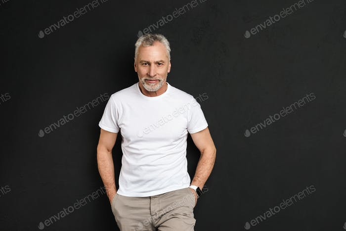 Handsome mature old man standing isolated