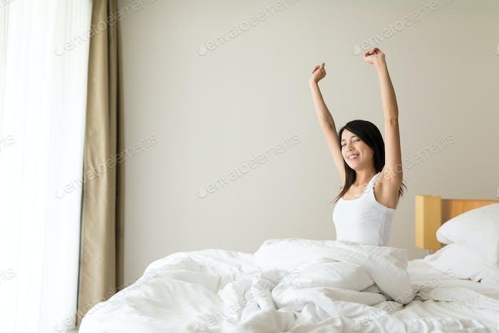 Woman wake up at morning