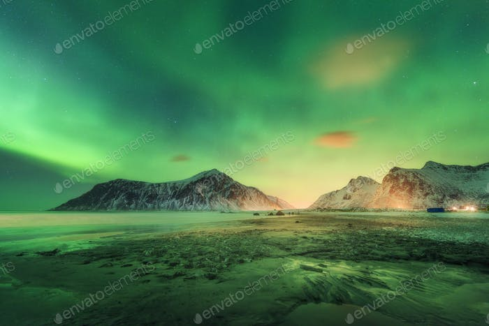 Northern lights on the beach in Lofoten islands, Norway