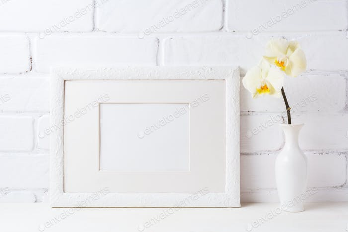 White frame mockup with soft yellow orchid in vase