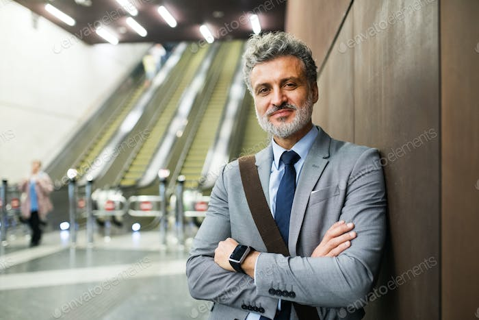 Mature businessman on a metro station.