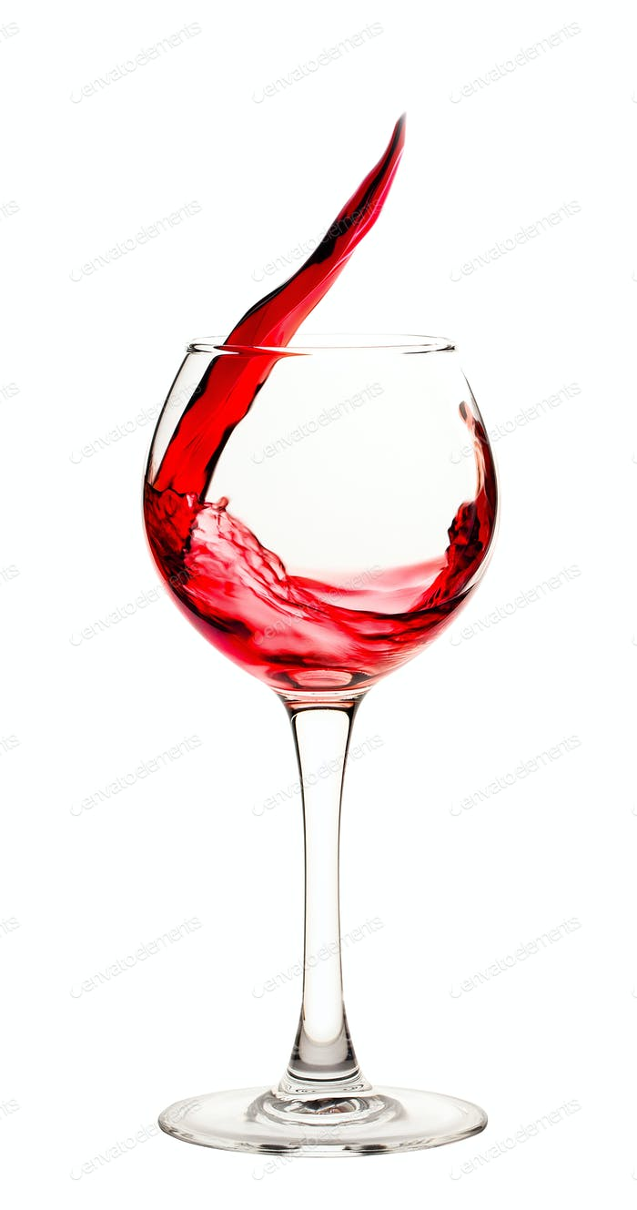 Splash of red wine in a glass goblet