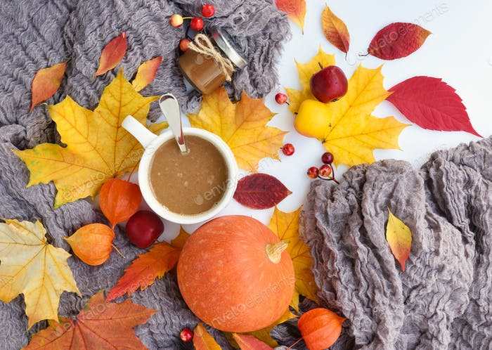 Autumn composition. Fall leaves, cup of coffee, pumpkin and scar