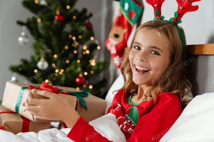 Cheerful happy girl wearing toy deer horns