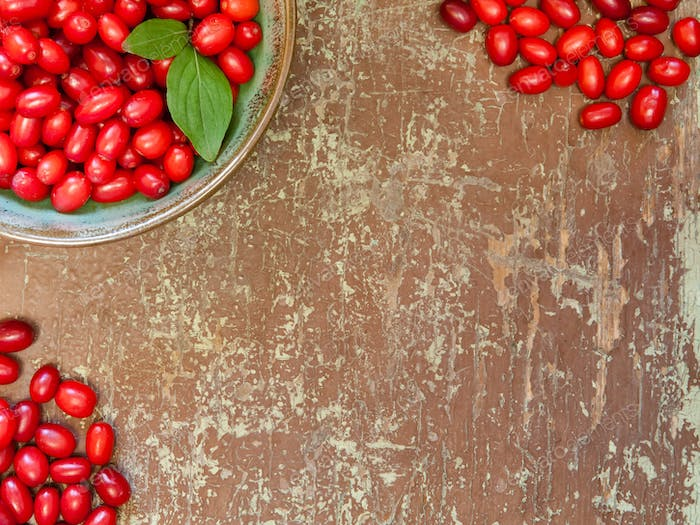 Red berries on wooden background