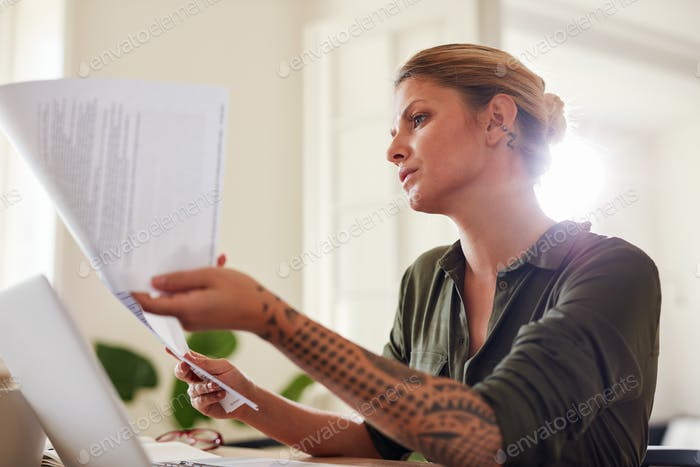 Woman  going through some paperwork at home