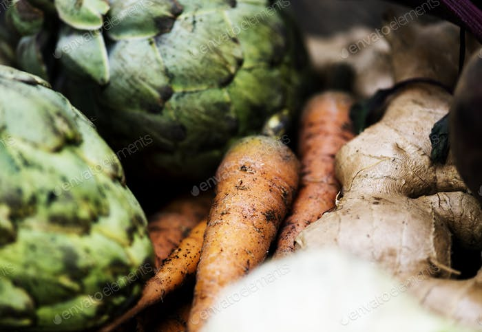 Closeup of carrots with artichoks and ginger