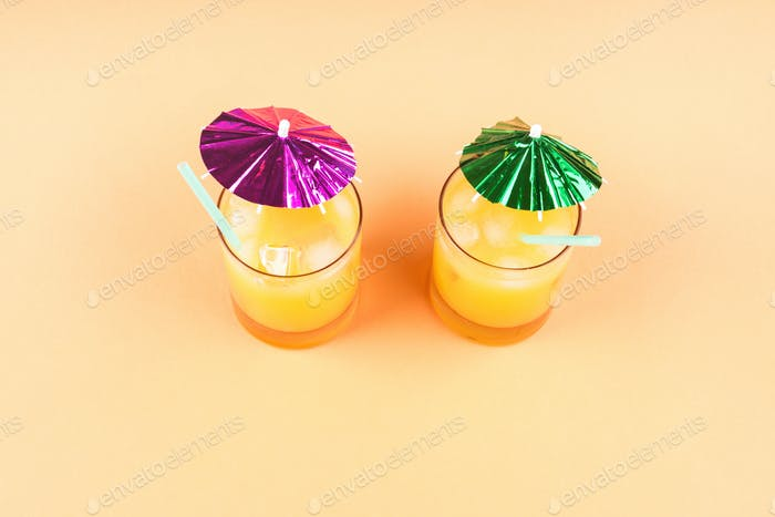 Summer orange ananas cocktails with umbrellas