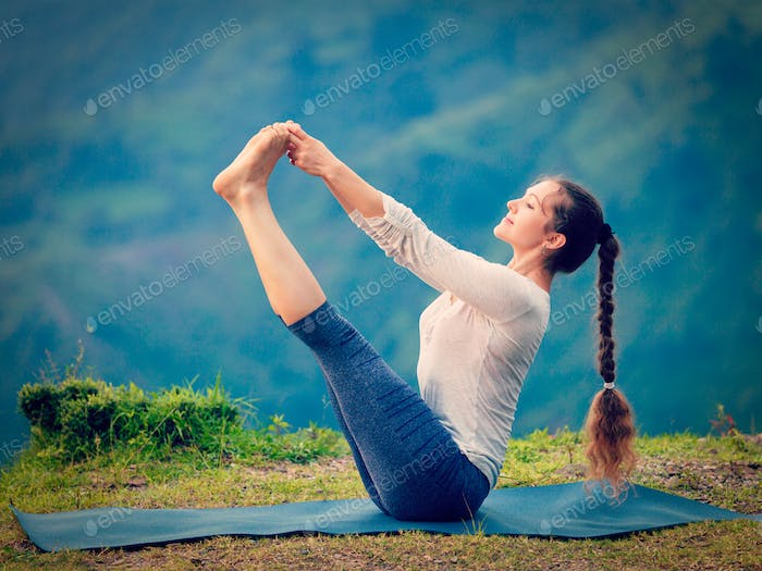 Woman doing Ashtanga Vinyasa Yoga asana outdoors