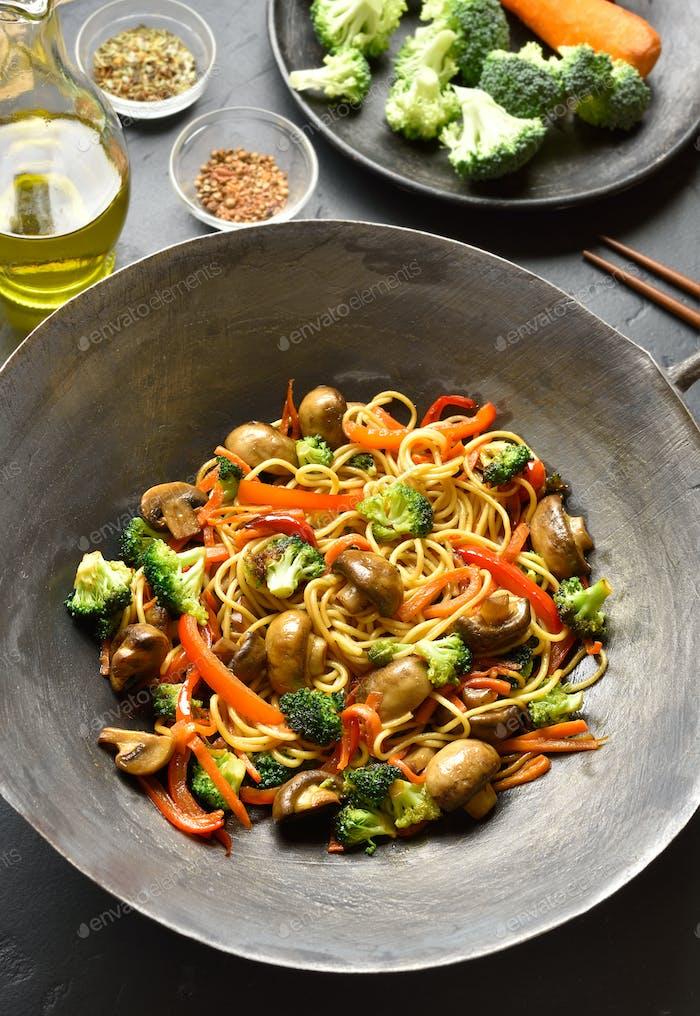 Udon stir-fry noodles with vegetables in wok