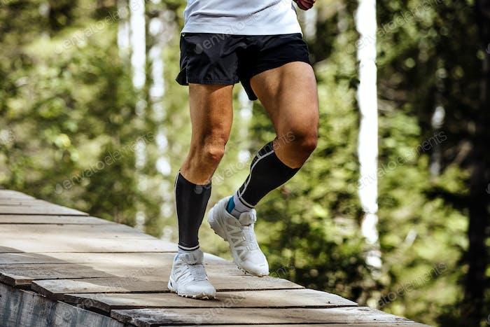 man runner in compression socks