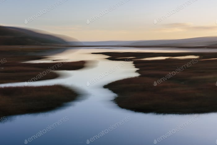 Blurred motion abstract of estuary and wetlands