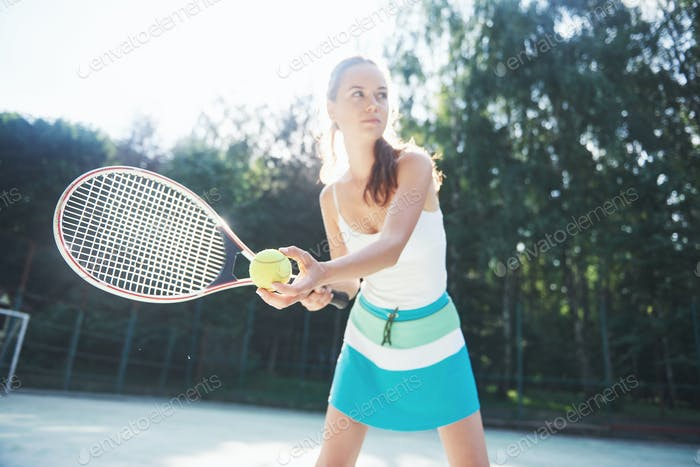 A pretty woman wearing a sportswear tennis court on the court