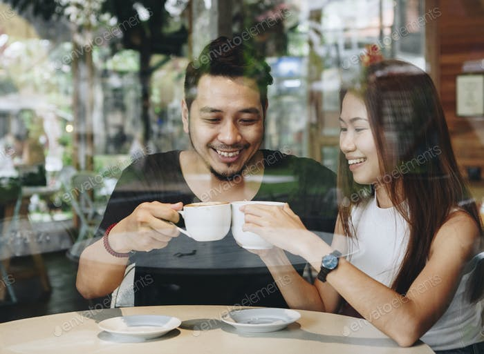 Lovely asian couple having coffee