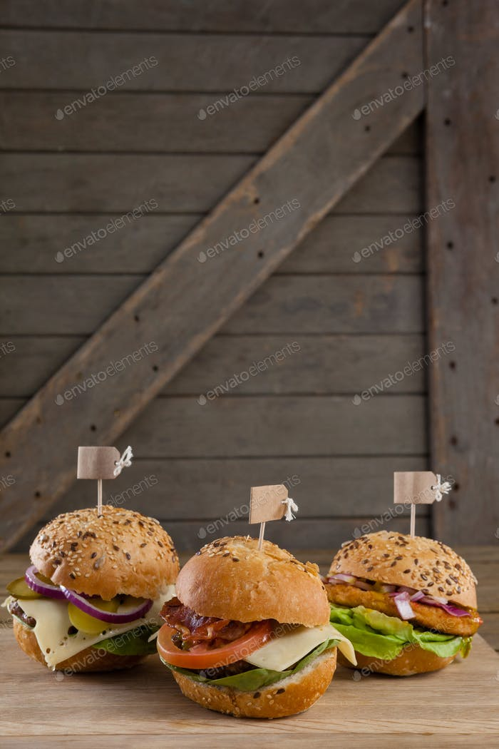 Various hamburger with tag on wooden table