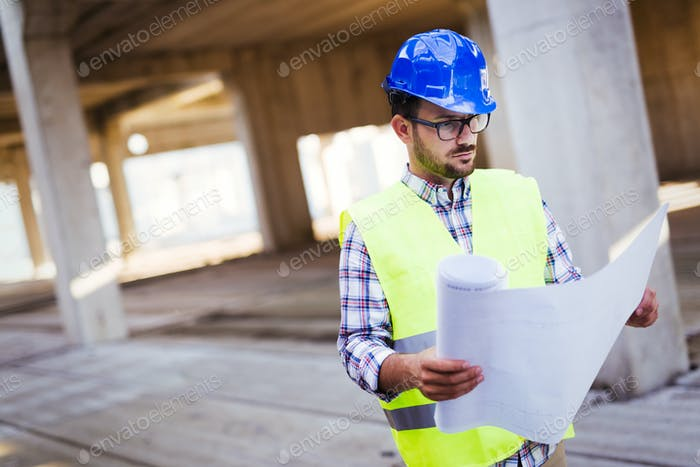 Young handsome business man construction site engineer