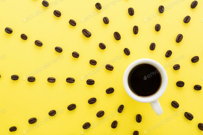Cup of Coffee Espresso with Sun Rays of Coffee Beans on Yellow Background.