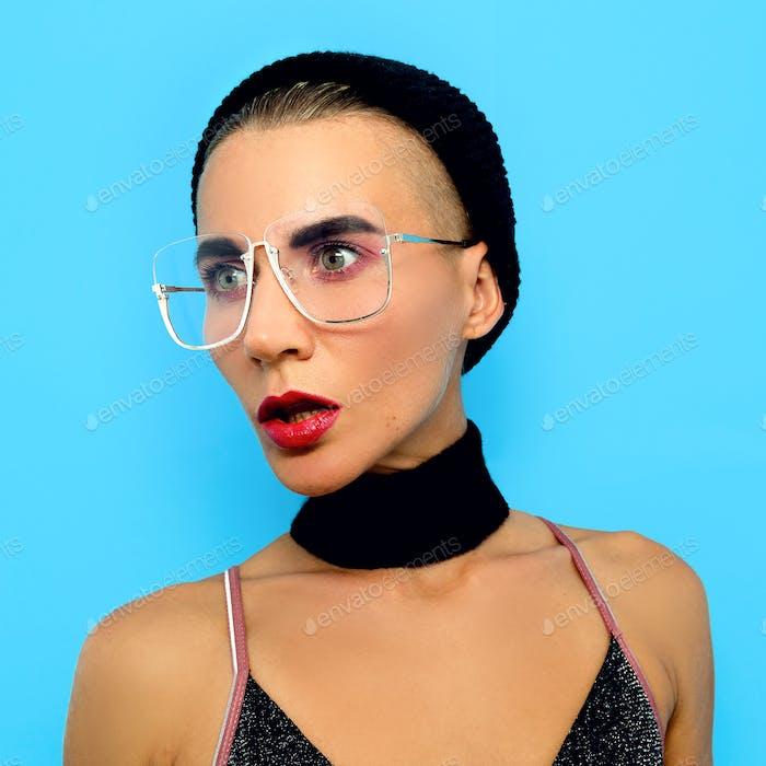 Tomboy Lady  in fashion glasses. Fashion accessory of the season