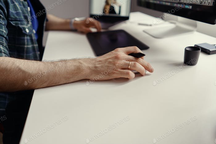 Designer working with interactive pen display