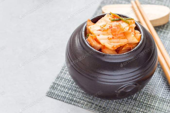 Kimchi cabbage. Korean appetizer in ceramic jar, horizontal, copy space