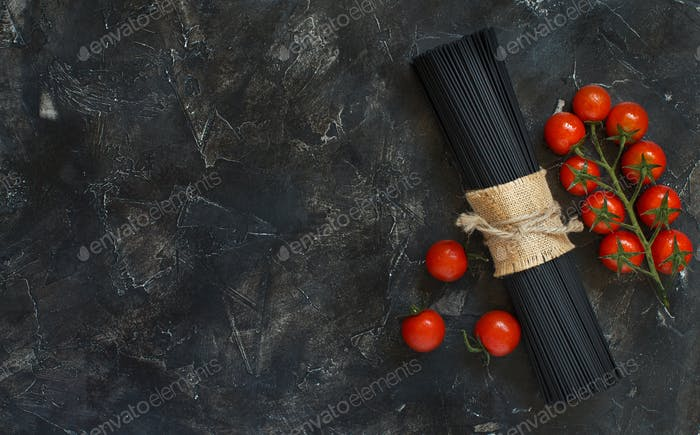 Raw squid ink pasta and tomatoes