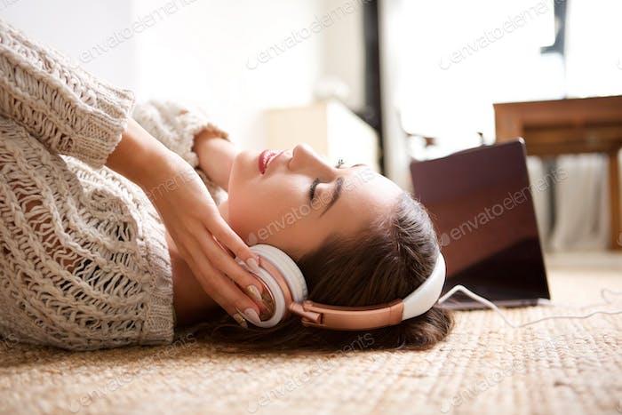 young woman sleeping with headphones