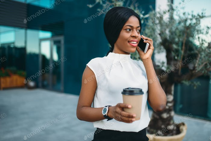 Business woman with coffee cup and mobile phone