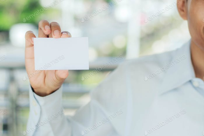 man holding white card