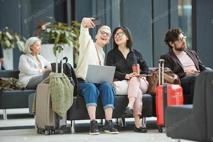 Girls Taking Selfie In Airport