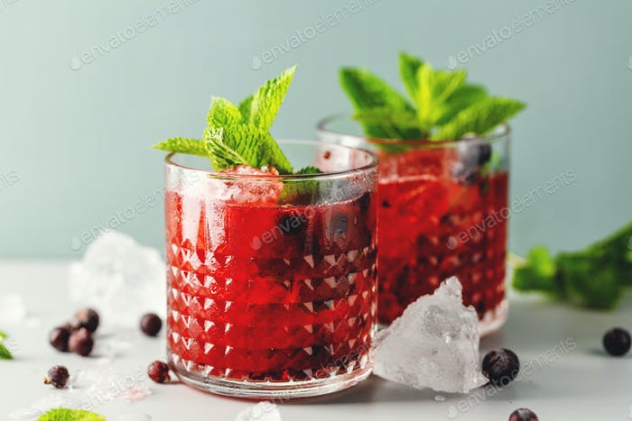 Freshmade cocktail with blackberry and mint