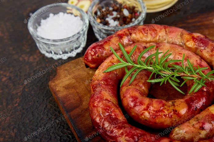 Grilled or Roasted spiral pork sausages with rosemary