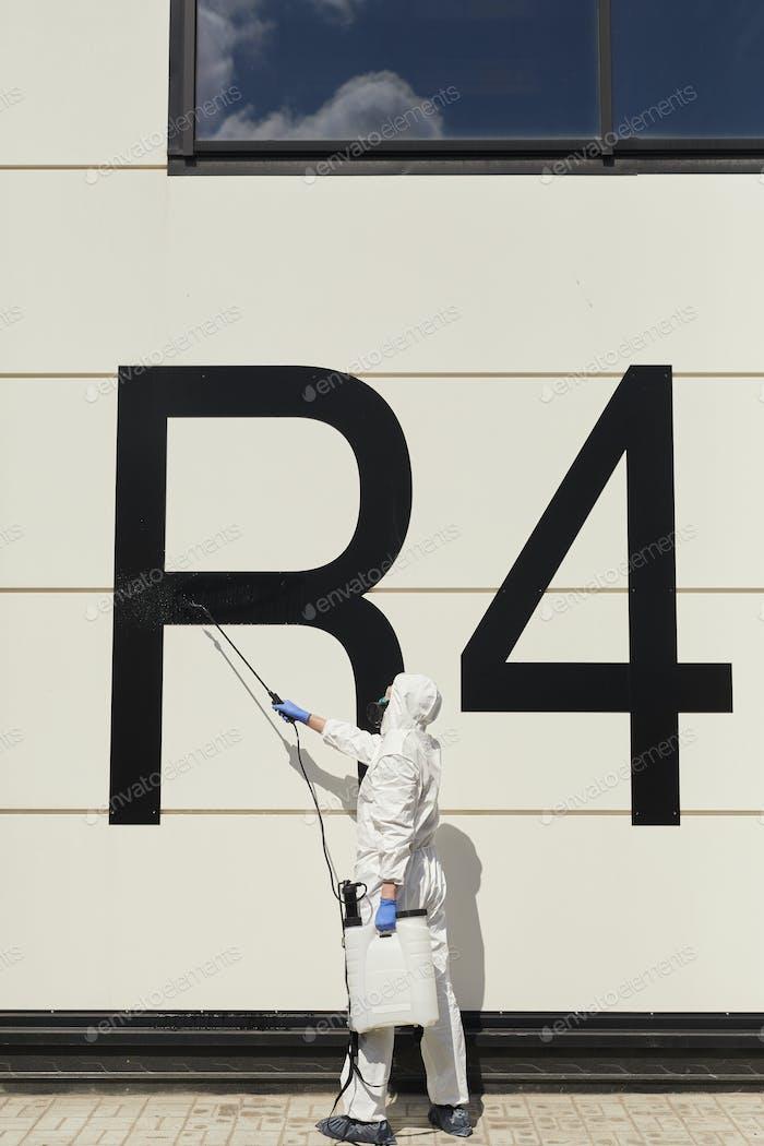Worker Disinfecting Hangar