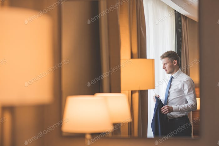 Young groom by the window