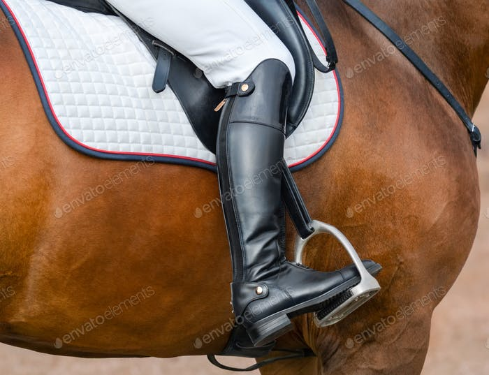 Jockey riding boot in the stirrup.