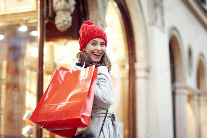 Portrait of happy woman during Christmas shopping