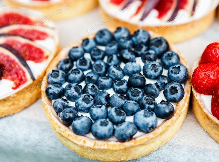 Closeup of blueberry tart dessert tray assorted