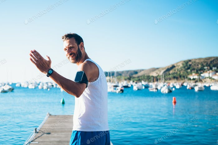 Man on pier with greeting gesture