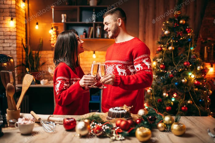 Couple holds glasses with champagne, christmas