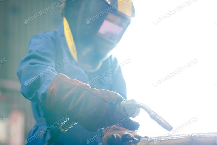 Woman Welding Metal