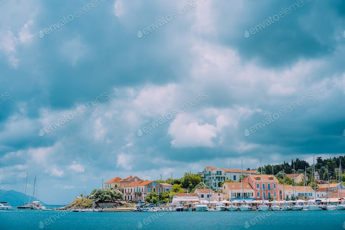 Cloudscape over sea and Fiskardo village, Kefalonia Island Greece