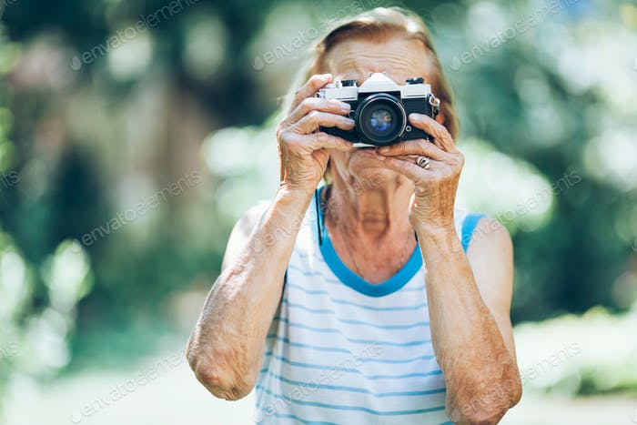 Elderly woman with a photo camera