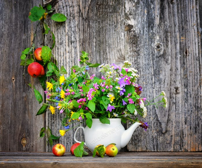 Autumn bouquet of wild flowers and apples