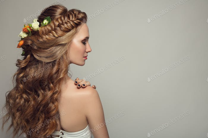 Close Up Portrait Of Young Beautiful Woman With Flowers.