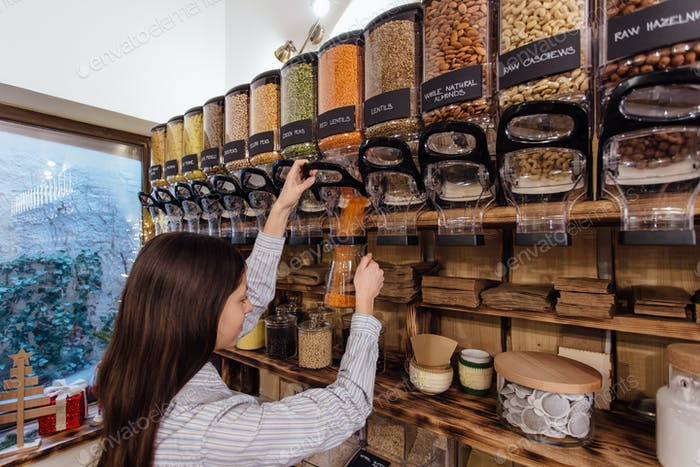 Shopkeeper working in zero waste shop.