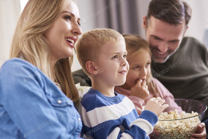 Close up of family watching tv at home