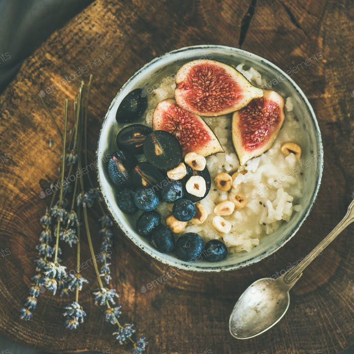 Rice coconut porridge with figs, berries and hazelnuts, square crop