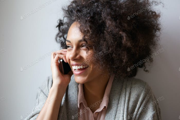 Young woman laughing and talking on mobile phone
